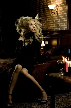 the very  pretty woman indoor in interior, blonde  tousled long hair  Stock Photo