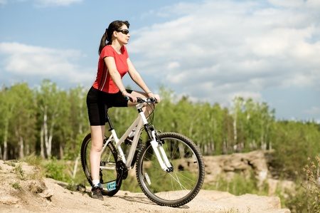 belle: The mature beautiful woman, on bicycle, stand on  beauty nature