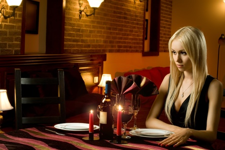 mournful: might-have-been romantic evening date in hotel room or in restaurant, unhappy solitary woman