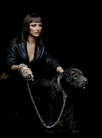 animal photo: the beautiful  young woman sit with dog on black background