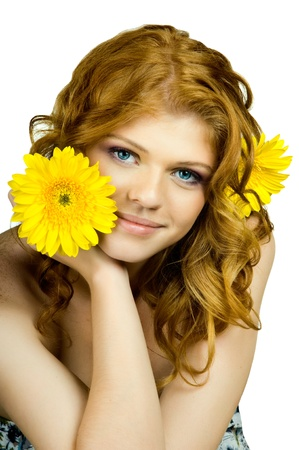 the very  pretty red-haired freckled young woman with yelow flowers , vertical  portrait, isolated photo