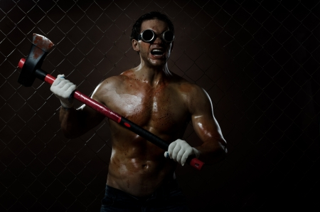 incensed: crazy frenzied chopper  butcher man covered with blood,  action with big axe  Stock Photo