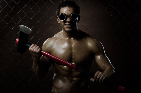 photo crazy frenzied chopper  butcher man ,  action with big axe Stock Photo - 11385874