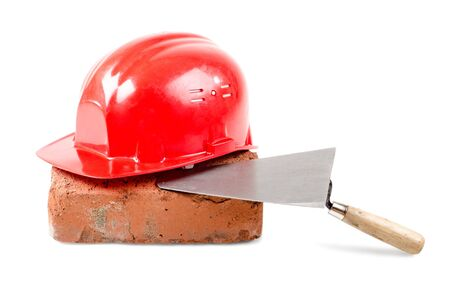 aegis: photo  beauty red  safety cap and  brick with  plane, close up on white background, isolated
