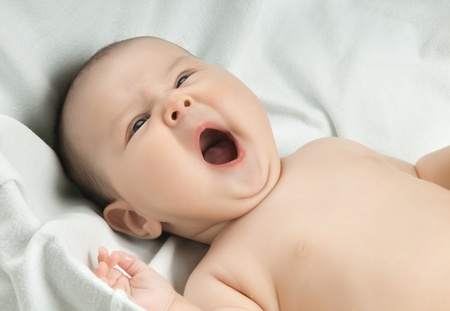 yawning: the little baby , lie and  crying at the top of ones voice Stock Photo