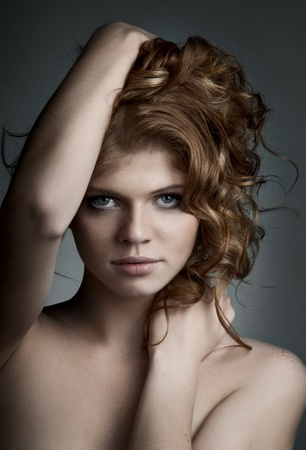the very  pretty red-haired young woman,  sensual look , vertical portrait photo