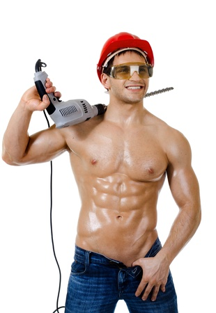 muscularity:  the beauty muscular worker driller man ,  hold  big perforator in hand and smile, vertical photo on white background, isolated