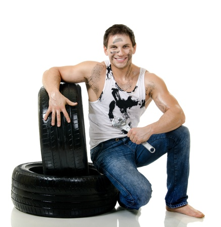 fellows: the very muscular handsome sexy guy hold rubber-tire and white,  on  white background, isolated