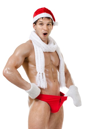 the very muscular  bronzed handsome sexy Santa Claus on white  background, isolated Stock Photo - 11391243