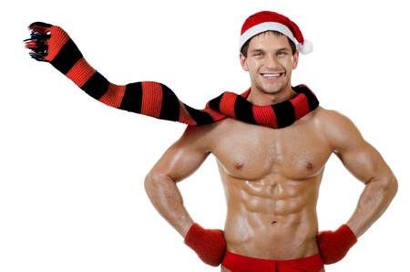 the very muscular  bronzed handsome sexy Santa Claus on white  background, posture with flutter muffler and to burst out laughing, isolated