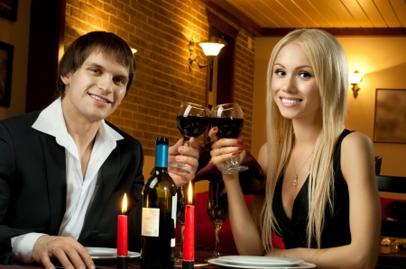 bedstead: romantic evening date in hotel room, or supper in restaurant, happy couple with wine glass
