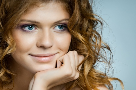 the very  pretty red-haired freckled young  dreamy woman  , horizontal portrait closeup photo