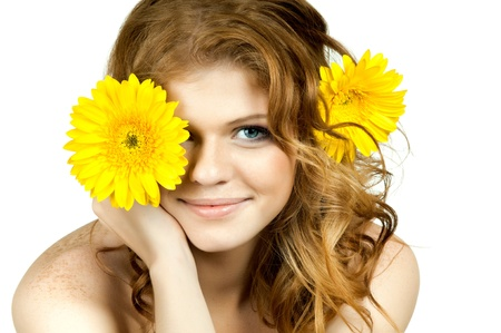 yelow: the very  pretty red-haired freckled young woman with yelow flowers , horizontal closeup portrait, isolated