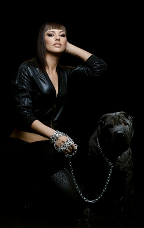 sharpei: the beautiful  young woman sit with dog on black background