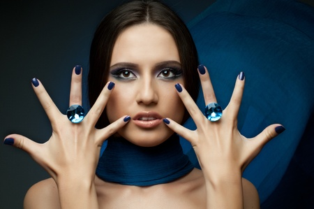 the very  pretty woman with dark blue neckerchief,  rings with huge blue brilliant, sensual sexuality gaze photo