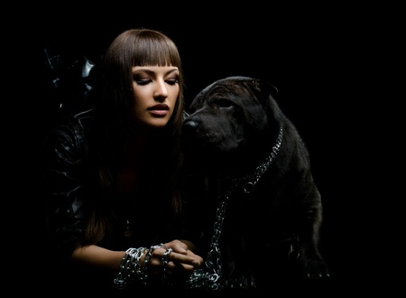 sexy image: the beautiful  young woman sit with dog on black background
