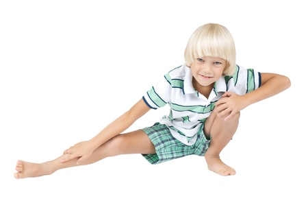 fulfil: the little children fulfil  physical training ,  hand up and smile, on white background, isolated Stock Photo