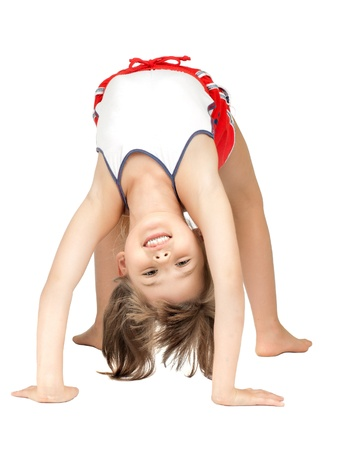 gymnastics sports: little children girl  stand head over heels and smile, on white background, isolated