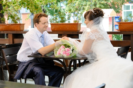 cutie: the cutie happy married couple bride in street restaurant; smile Stock Photo