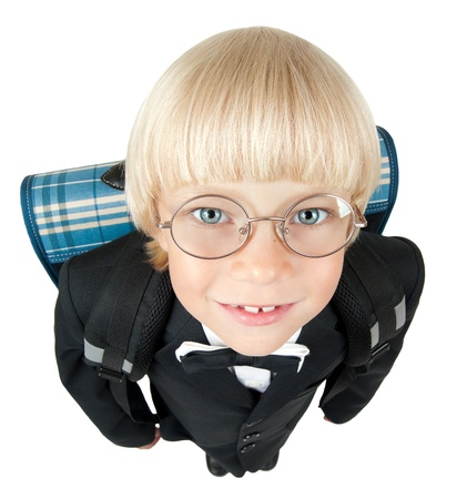 little children  schoolboy stare on camera through glasses and smile, on white background, isolated photo