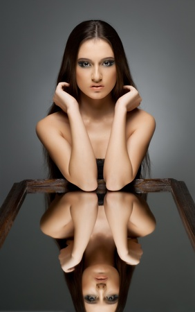 the very  pretty woman with  reflect in mirror, sensual sexuality gaze photo