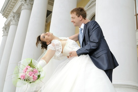 ardently:  cutie happy married  couple  hot embrace  on architecture background, smile