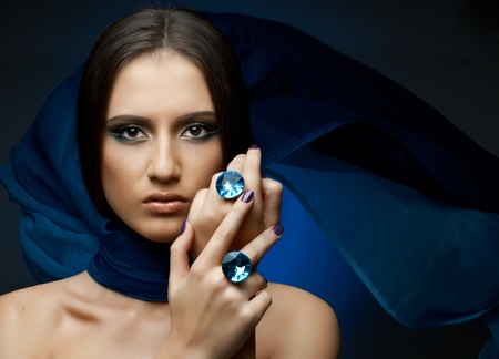 the very  pretty woman with dark blue neckerchief,  rings with huge blue brilliant, sensual sexuality gaze Stock Photo - 11971892