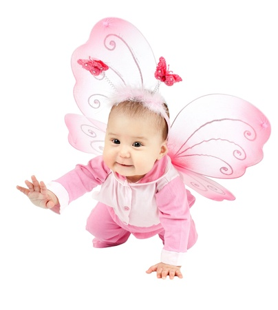 beautiful  little kid with wings, sit and  smile on white background, isolated
