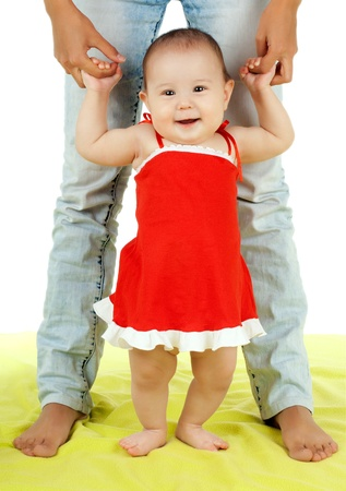 the very  beautiful  little kid , learn  walk with mother,  on white background, isolated Stock Photo - 11971880
