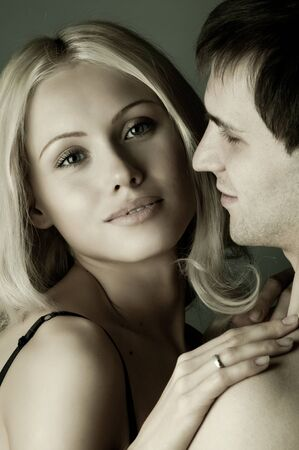 vehement: guy with pretty woman, happy couple, very close face, girl look on camera Stock Photo