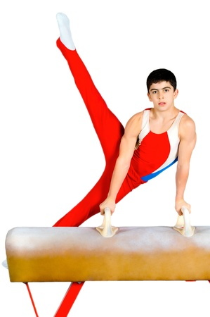 vertical bars: The sportsman the guy, carries out difficult exercise, sports gymnastics, on white background, isolated
