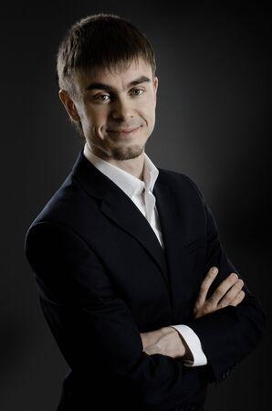 careerist: portrait  the  beautiful  businessman careerist in black costume without necktie