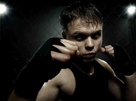 horizontal photo  muscular young  guy street-fighter,  aggression look, hard light photo