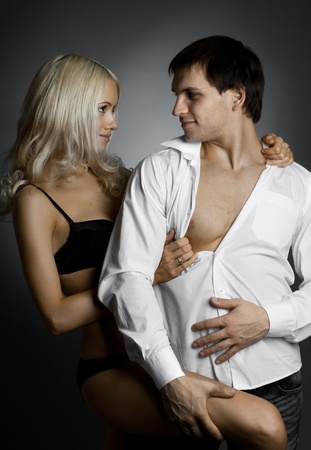 muscular handsome sexy guy with pretty woman, on dark background, glamour  light Stock Photo - 12062517
