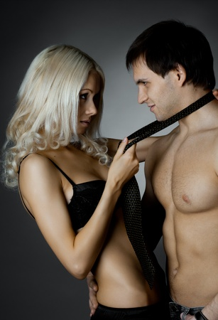 muscular handsome sexy guy with pretty woman, on dark background, glamour  light Stock Photo - 12071531
