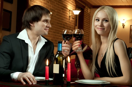 romantic evening date in hotel room, or supper in restaurant, happy couple with wine glass Stock Photo - 12062519