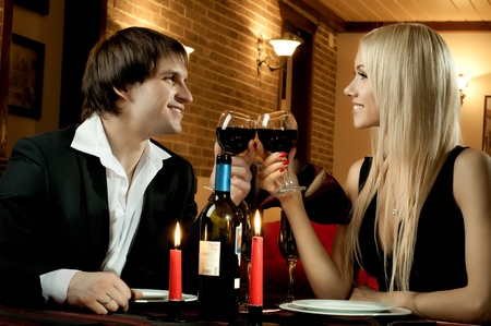 romantic evening date in hotel room, or supper in restaurant, happy couple with wine glass Stock Photo - 12071554