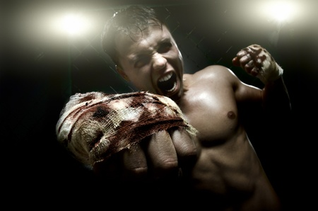 horizontal photo  muscular young  guy street-fighter, cuff  fist close up on camera and yell , hard light