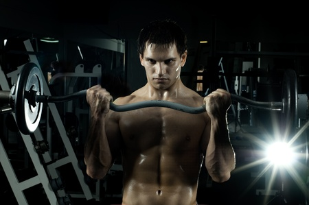 very power athletic guy ,  execute exercise with  weight, in  sport-hall, beauty glamour light Stock Photo - 12228943