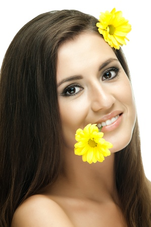 yelow: the very  pretty  young woman with yelow flowers , vertical  portrait, isolated