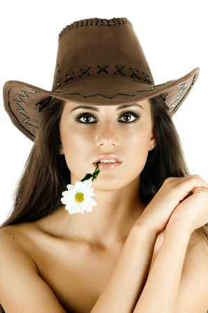 the very  pretty woman on white background in cowboy-hat, with camomile, sensual sexuality gaze, isolated Stock Photo - 12229082