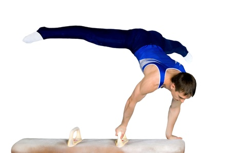gymnast: The sportsman the guy, carries out difficult exercise, sports gymnastics, on white background, isolated