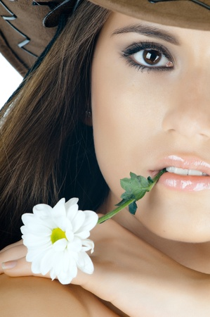 the very  pretty woman on white background, with camomile, sensual sexuality gaze , very close face photo