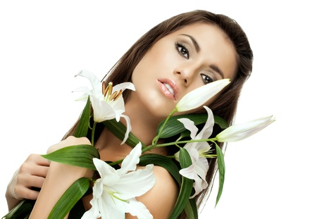 the very  pretty woman on white background, with lily, sensual sexuality gaze  photo