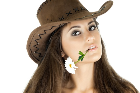 the very  pretty woman on white background in cowboy-hat, with camomile, sensual sexuality gaze, isolated Stock Photo - 12229073