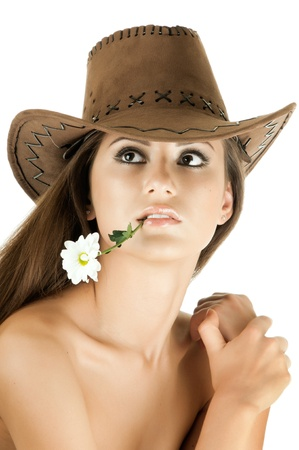 the very  pretty woman on white background in cowboy-hat, with camomile, sensual sexuality gaze, isolated photo