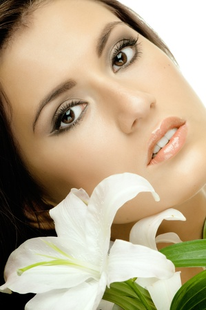 the very  pretty woman on white background, with lily, sensual sexuality gaze , very close face Stock Photo - 12229072