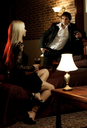 romantic evening date in hotel room, guy with  sexy girl,  on bed Stock Photo - 12466081