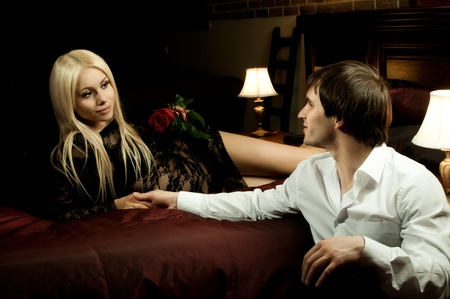 romantic evening date in hotel room, guy with  sexy girl,  on bed Stock Photo - 12466082