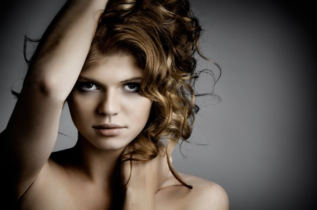 the very  pretty red-haired young woman,  sensual look , horizontal portrait photo